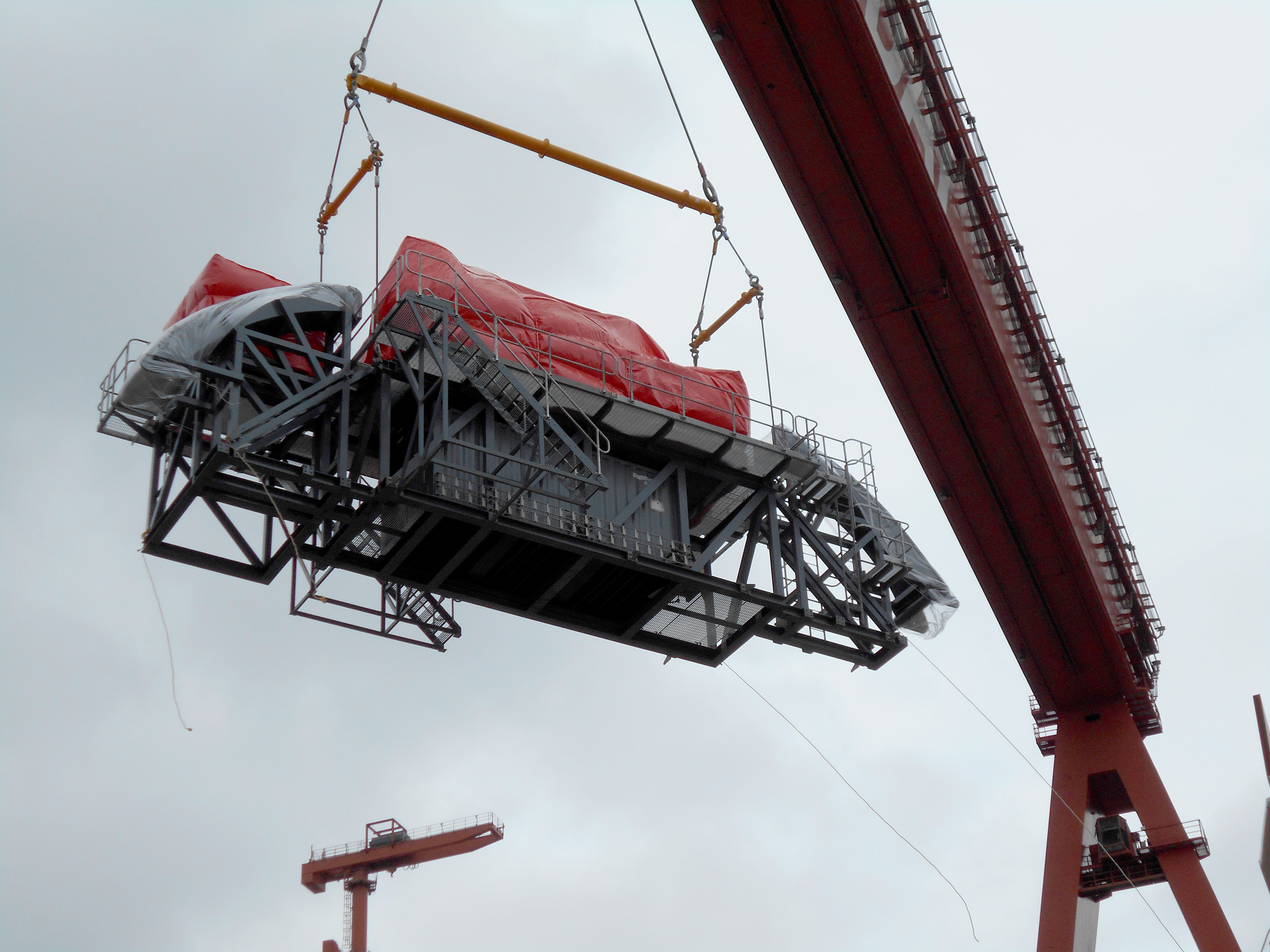 Modulift Spreader Beams in a one over two. Lifting a load of containers, power cabinets and a space frame